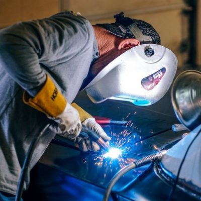 Man welding with a face mask